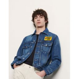 Denim jacket embroidered with patch