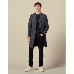 Coat fastened with three buttons