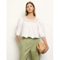 Loose-fitting top with puff sleeves