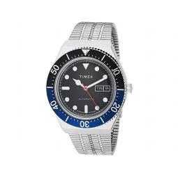 38 mm M79 Black/Blue Auto Silver Case Black Dial Silver Bracelet